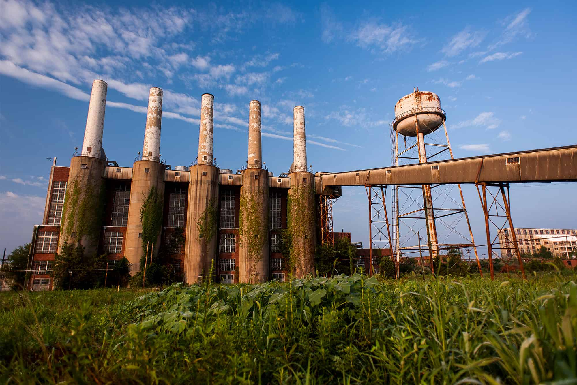 Abandoned energy plant with water tower on surplus property or brownfield sites