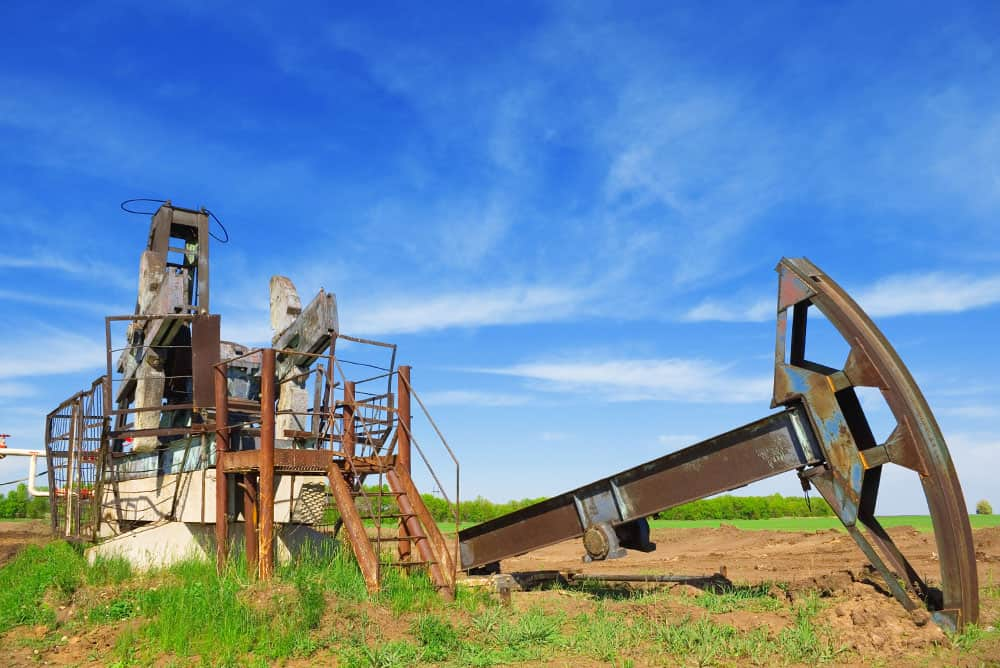 Abandoned oil pump on brownfield site requiring environmental remediation