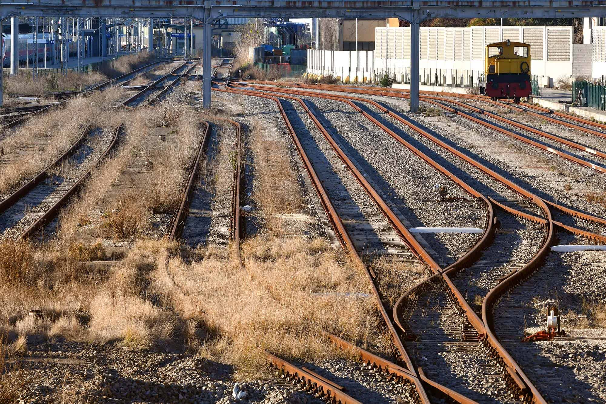 Railroad tracks in abandoned brownfield site requiring environmental remediation